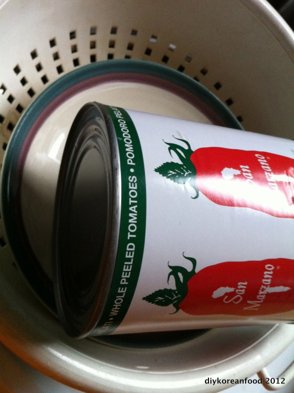 Squeezebox: A can of tomatoes for squeezing your tofu