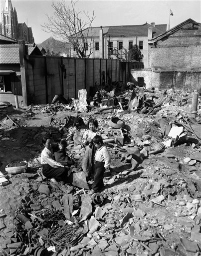 March 21, 1951: Mass of rubble was all this mother and her three children found of their home when they returned to Seoul  (AP Photo/James Martenhoff)