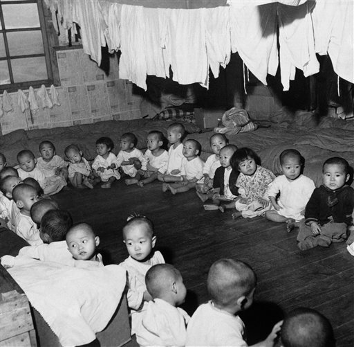 April 1, 1951: Korean youngsters sit in a circle during playtime in United Nations' orphanage on Cheju Island (AP/Photo)