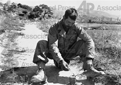Pvt. Joseph Vassallo, Chattanooga, Tenn., indulges in the relative luxury of a hot meal as...he heats a can of field ration...near the Naktong River front on Sept. 6, 1950. (AP Photo)